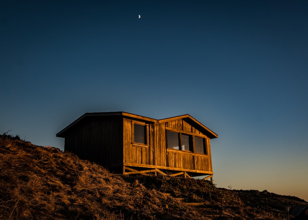 brown wooden house in top of mountain