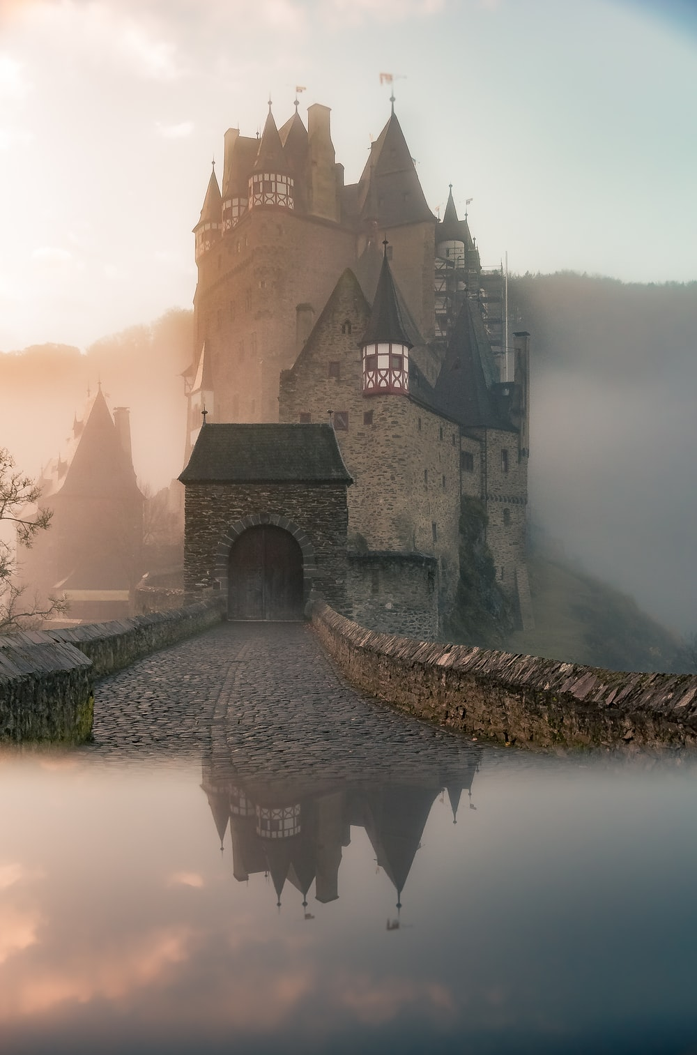 reflection of a castle surrounded with fogs