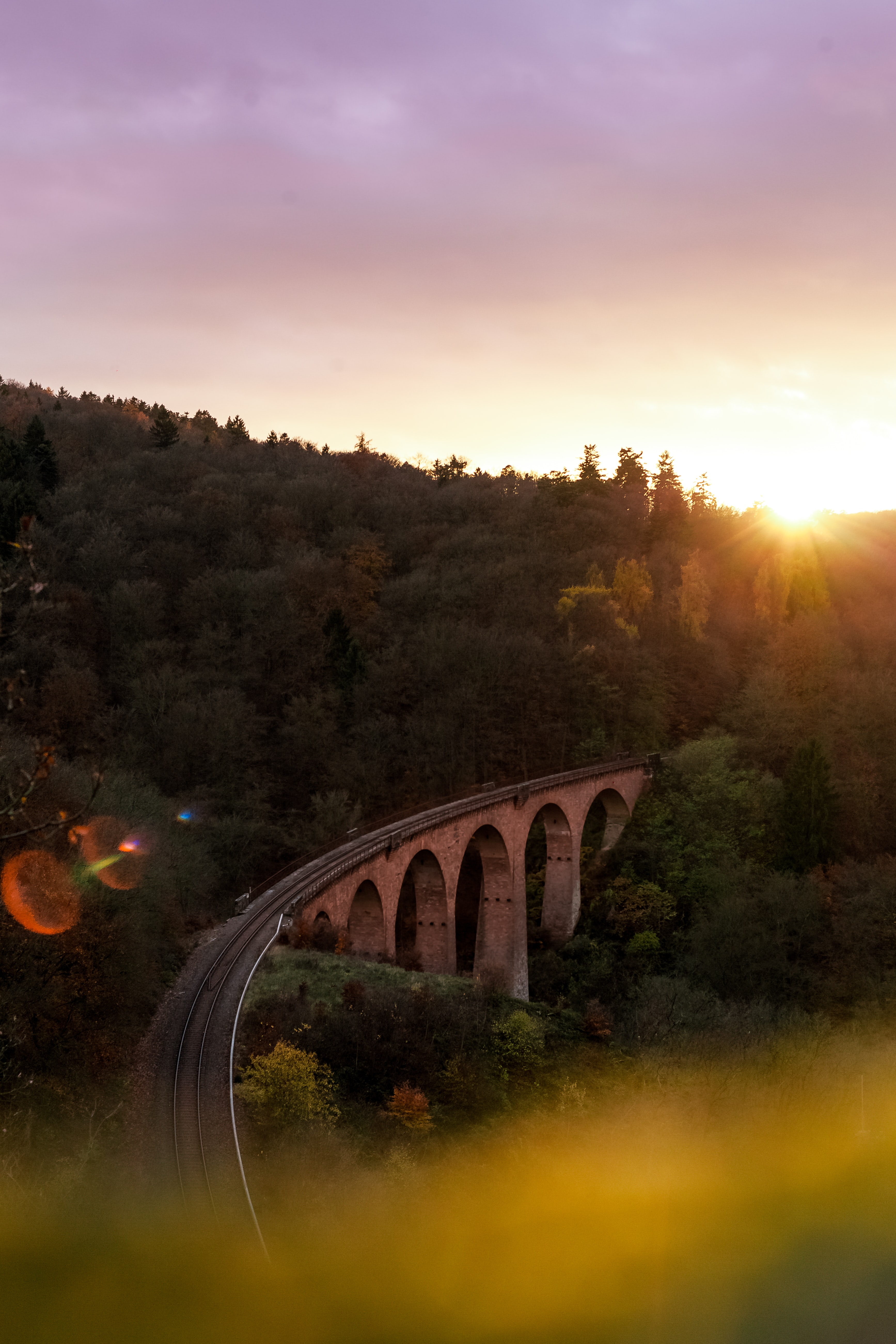 golden hour photography of railroad