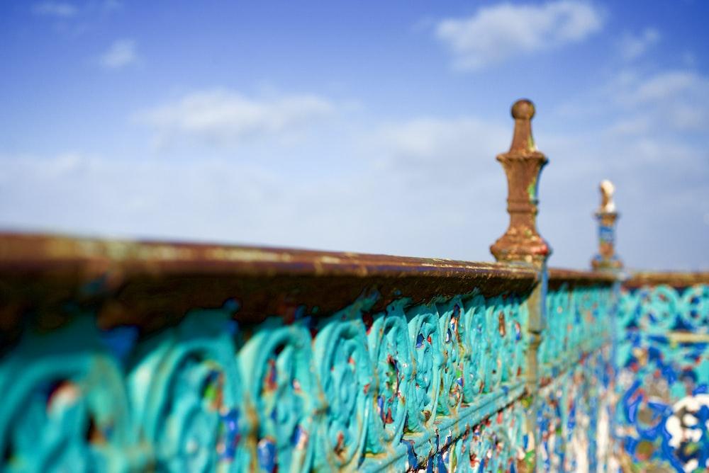 selective focus photo of brown metal pillar