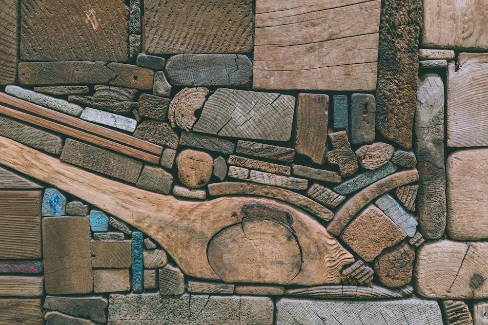high angle photography of brown wood bricks