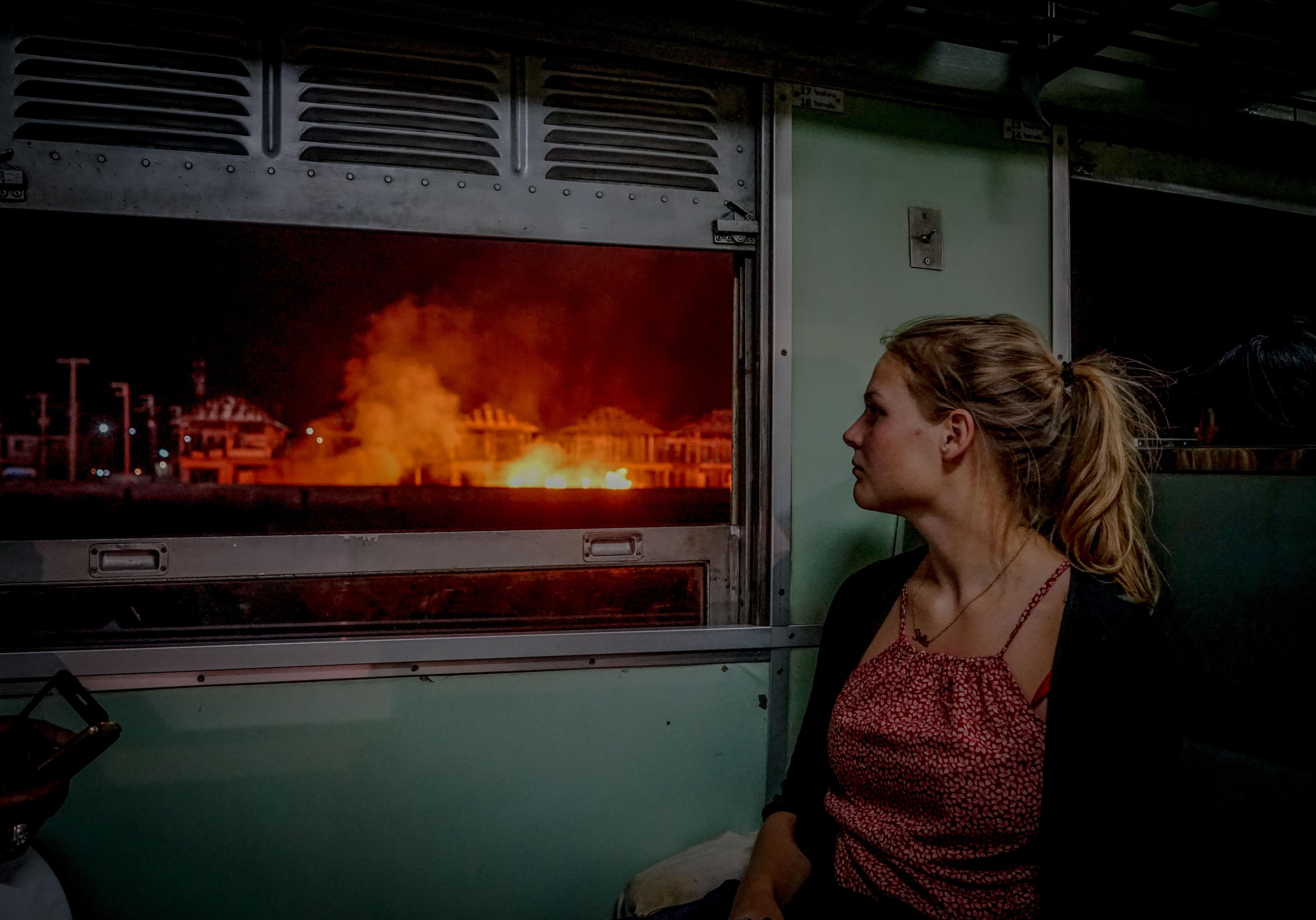woman sitting along window