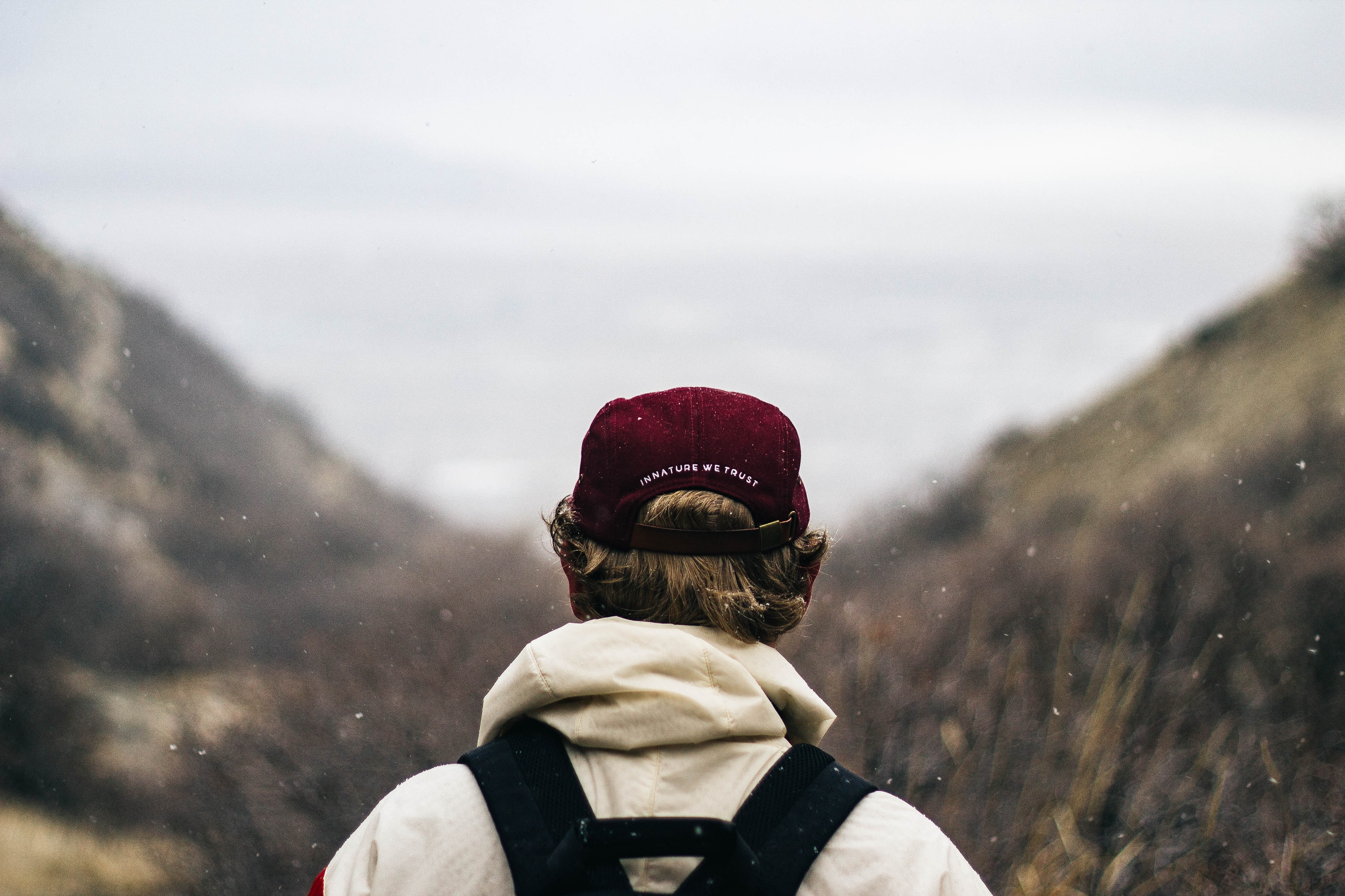 selective focus photography of person viewing mountains