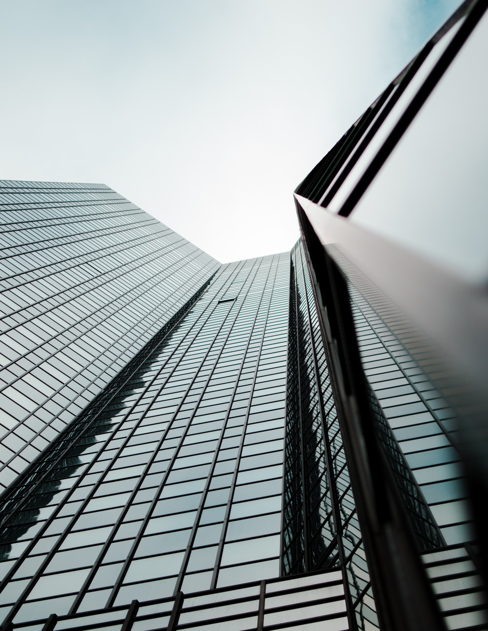 worm's eye view of glass building