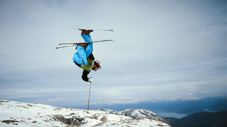man snow ski holding pole