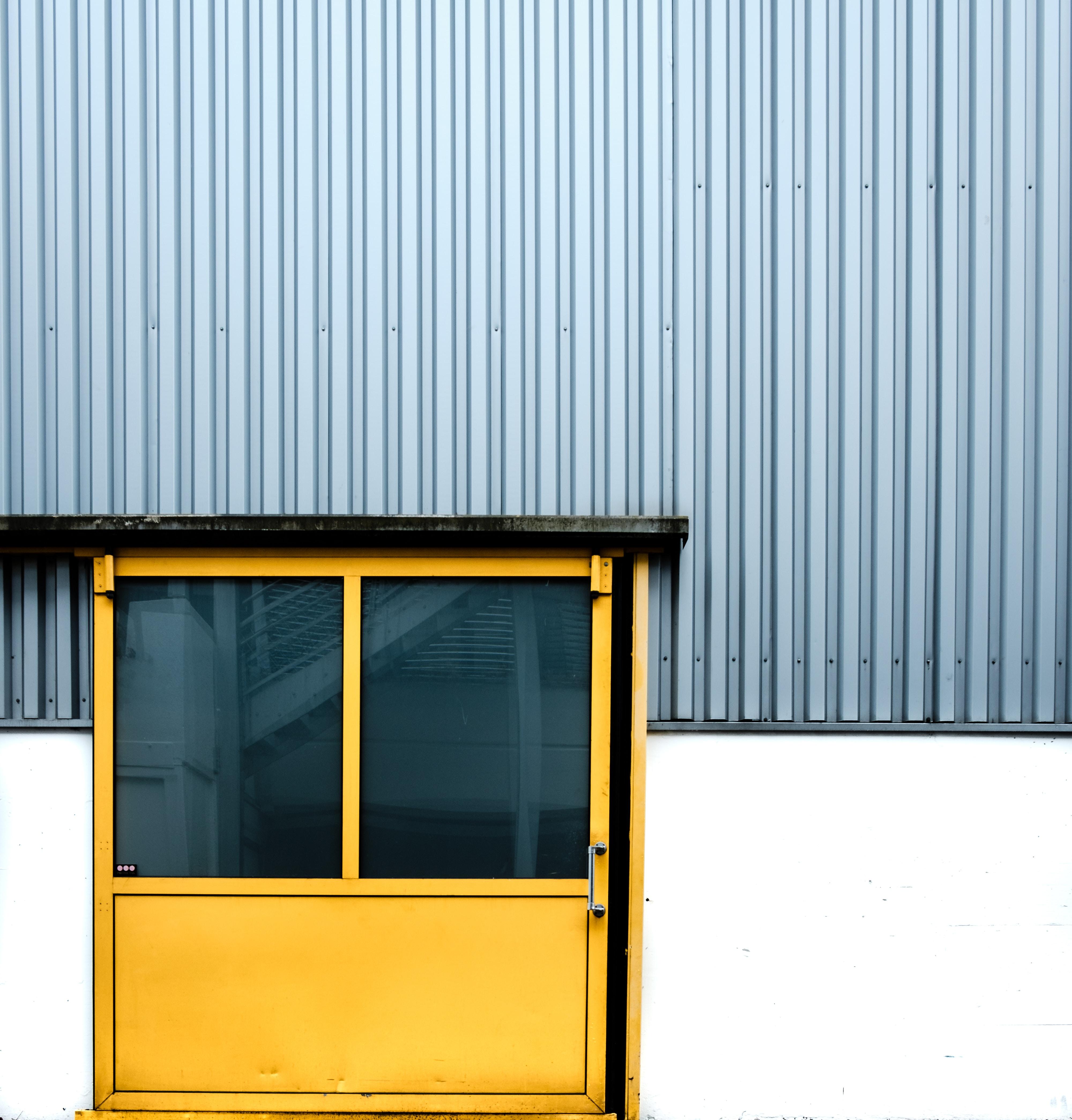 closed yellow metal door