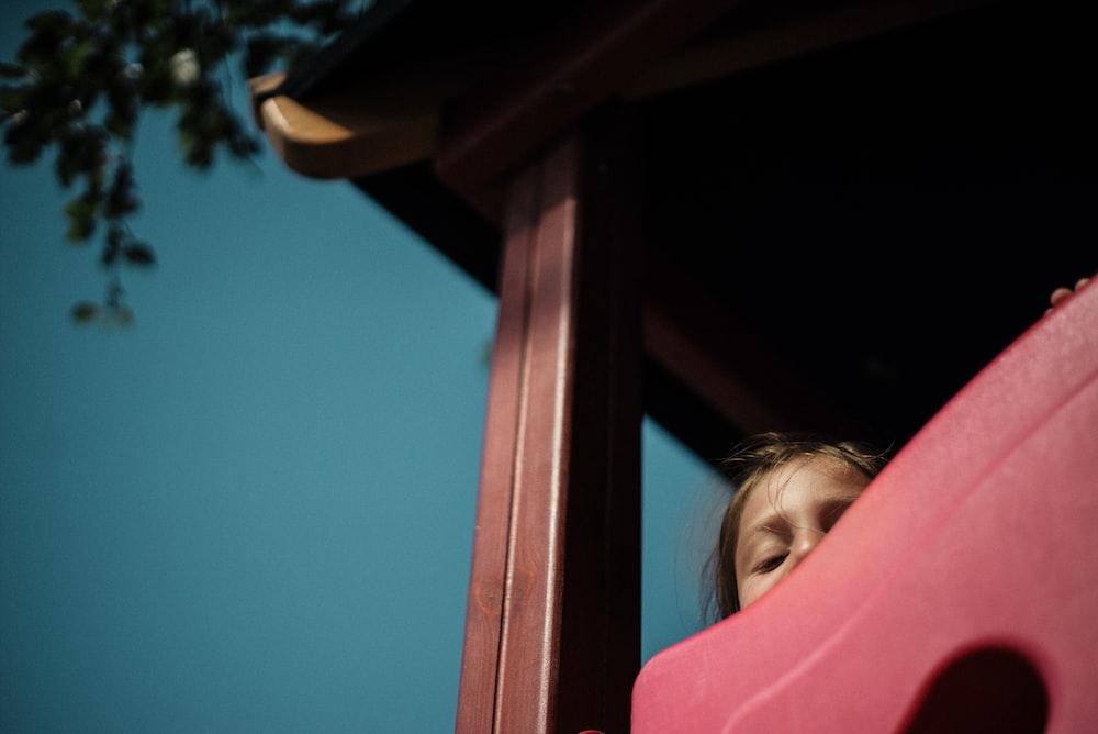 girl playing on play house