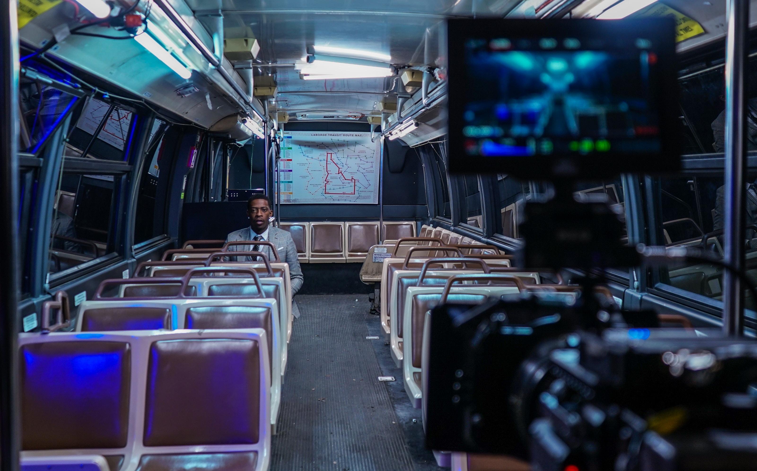 man sitting inside bus
