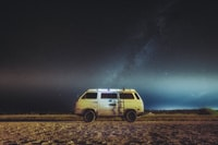 white and brown van parked under view of milky way