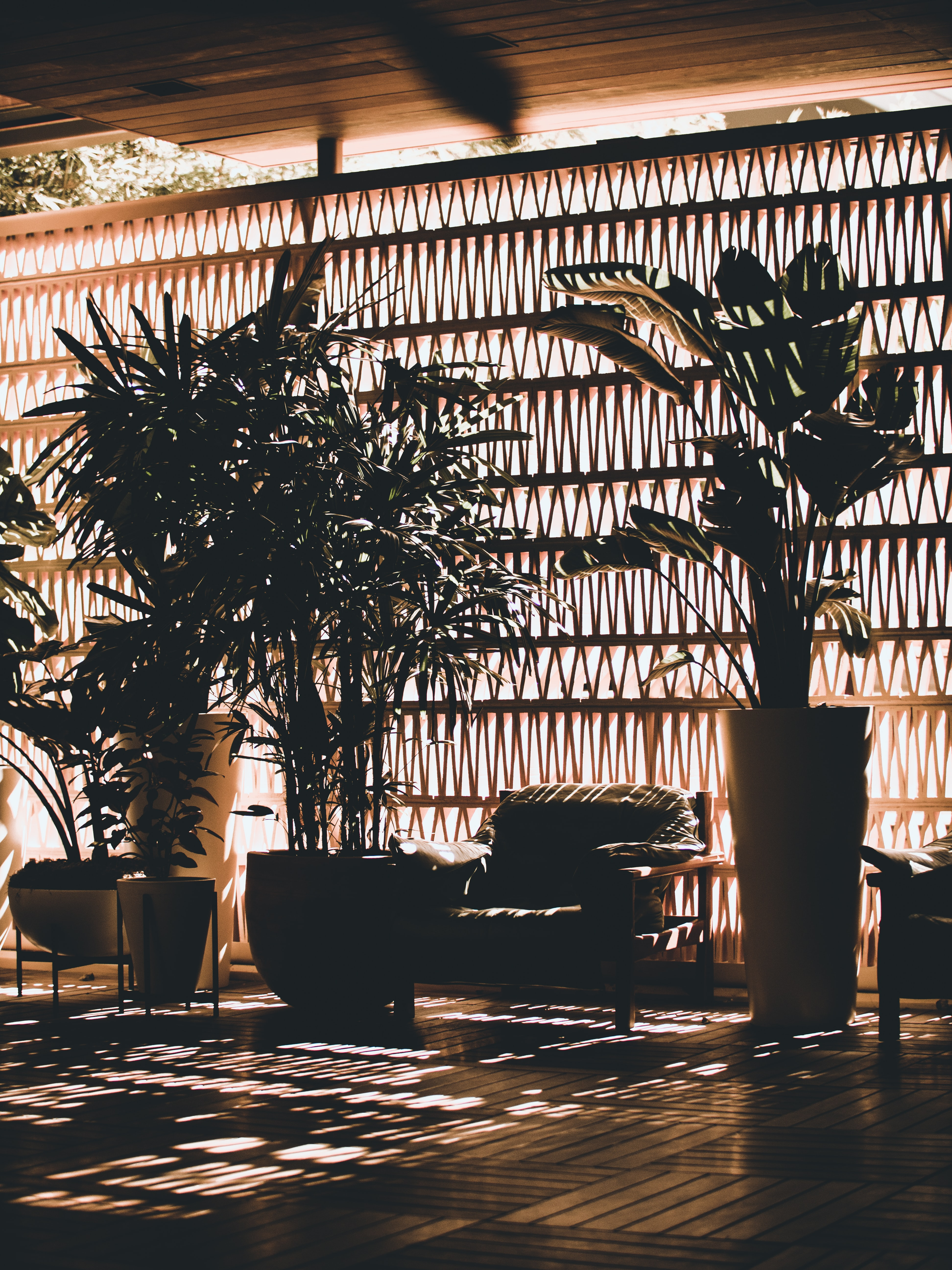 photo of sofa between vases