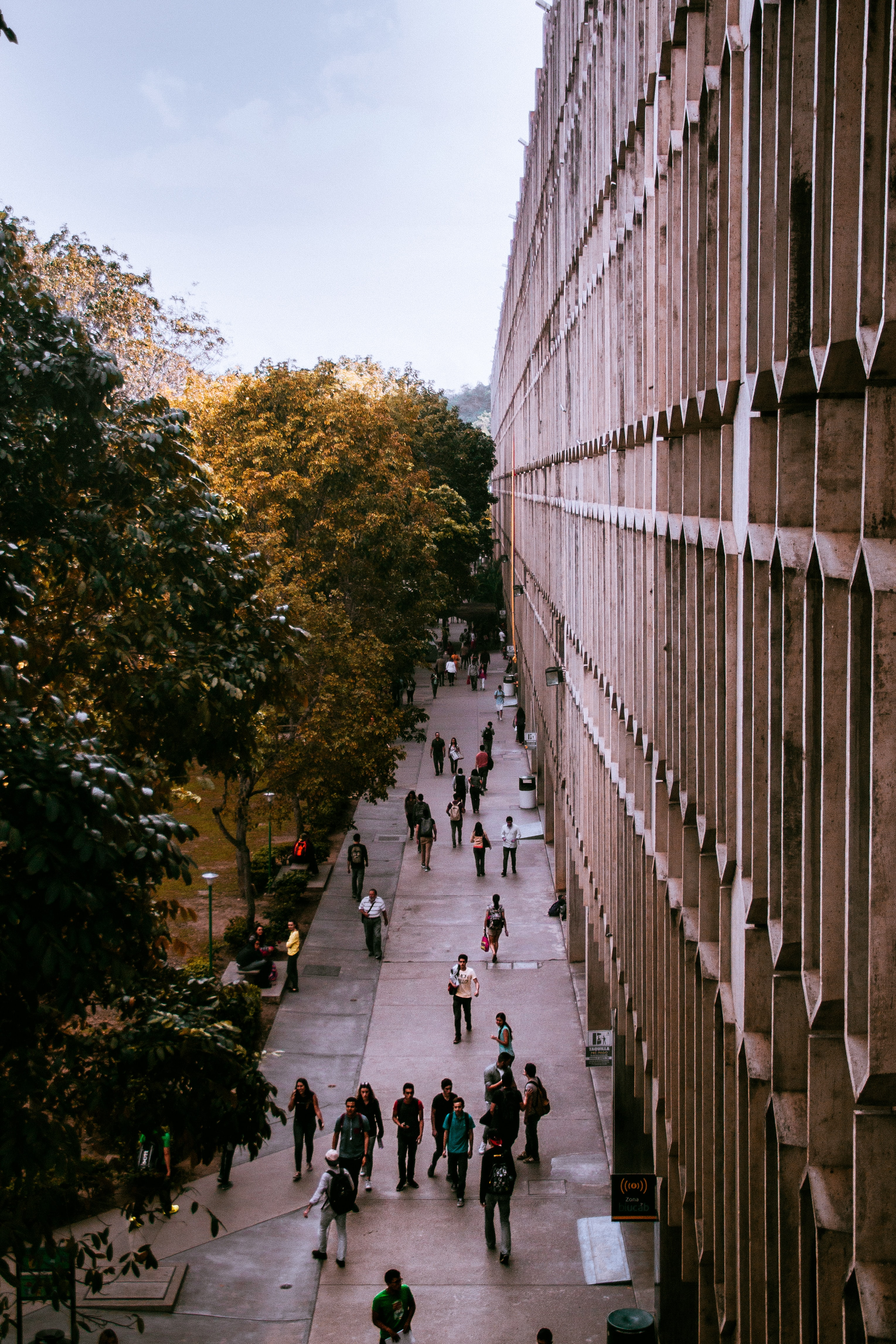 people passing gray building
