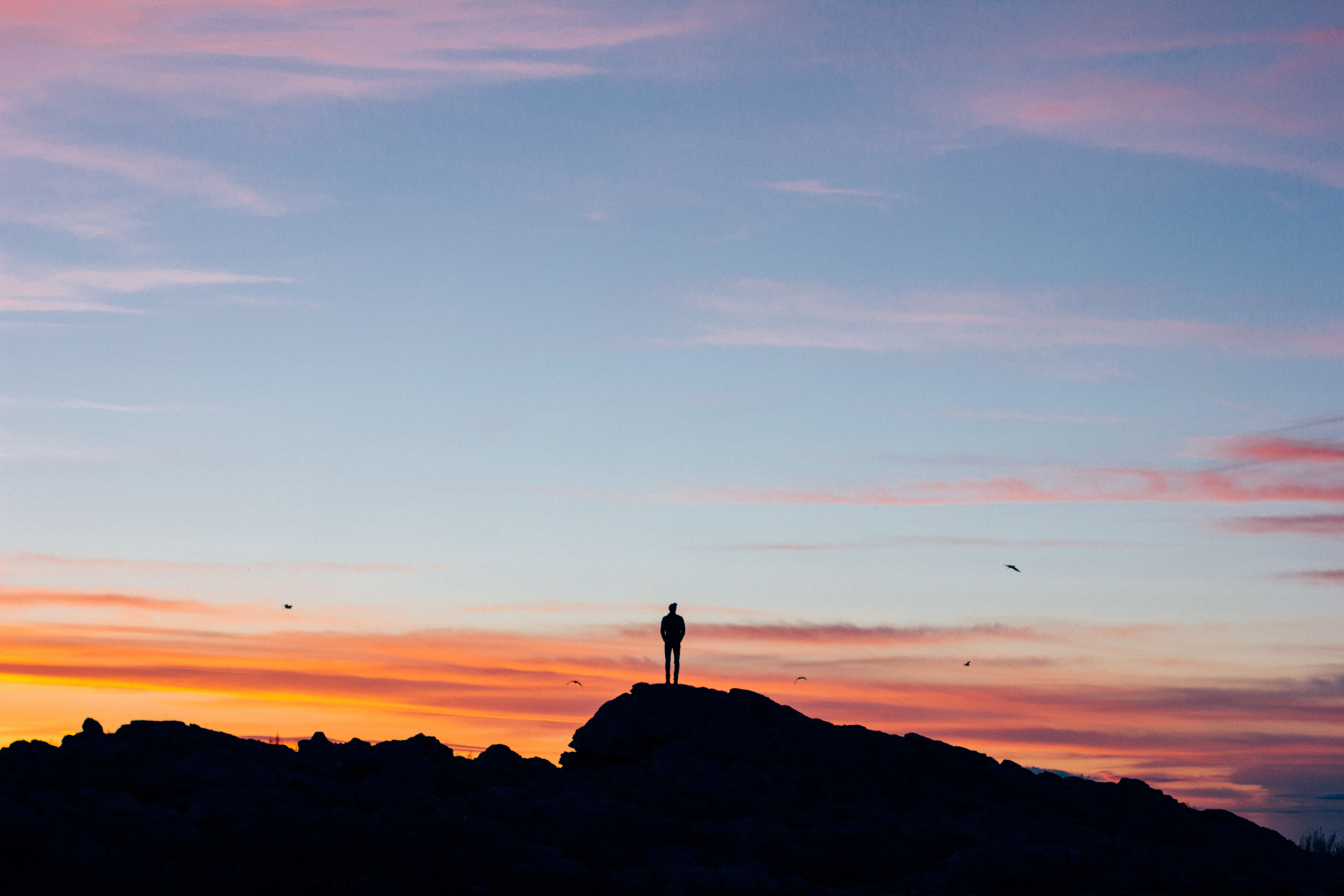 silhouette photography of man on mountain