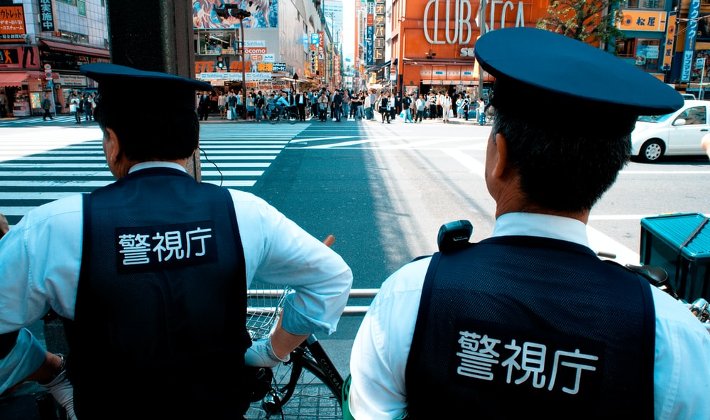 two policemen patrolling on road