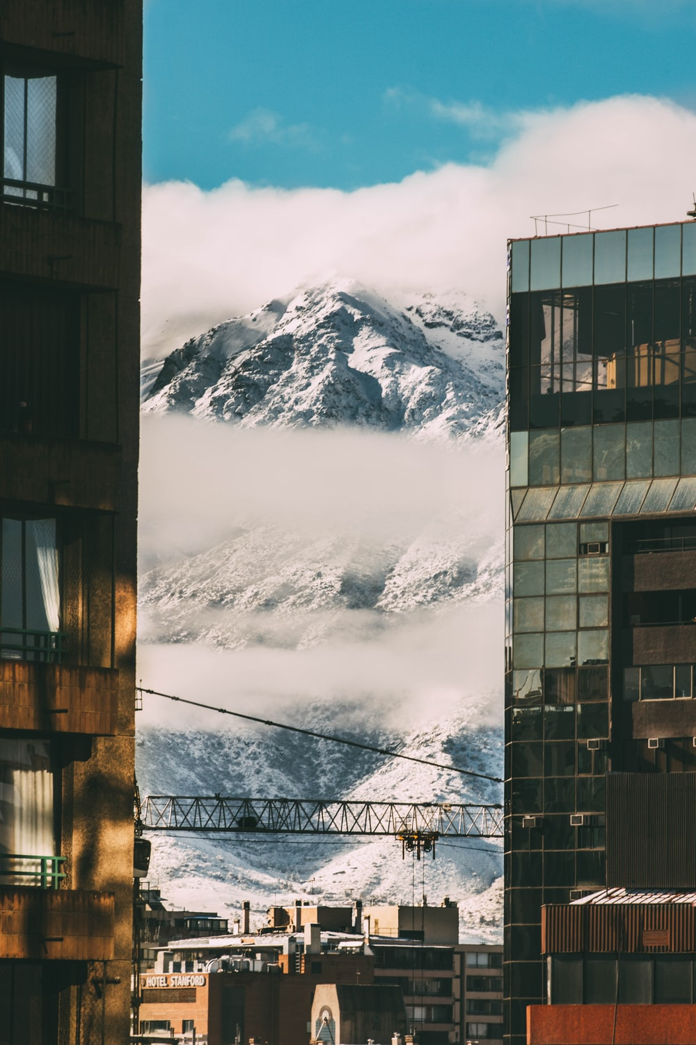 photo of mountain near buildings