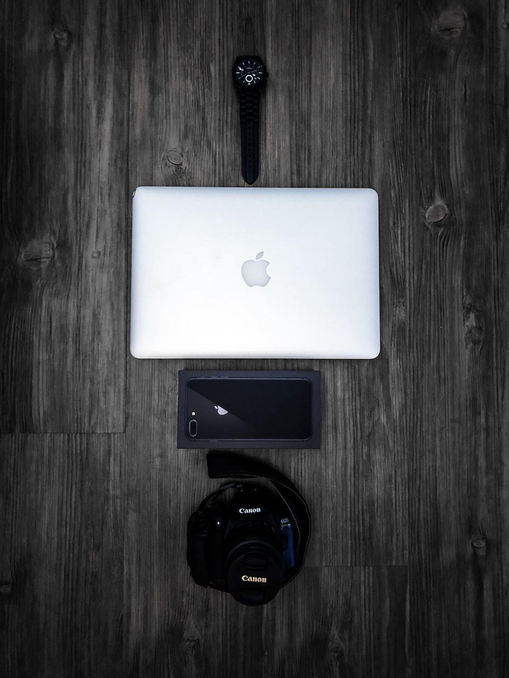 silver Macbook on grey table