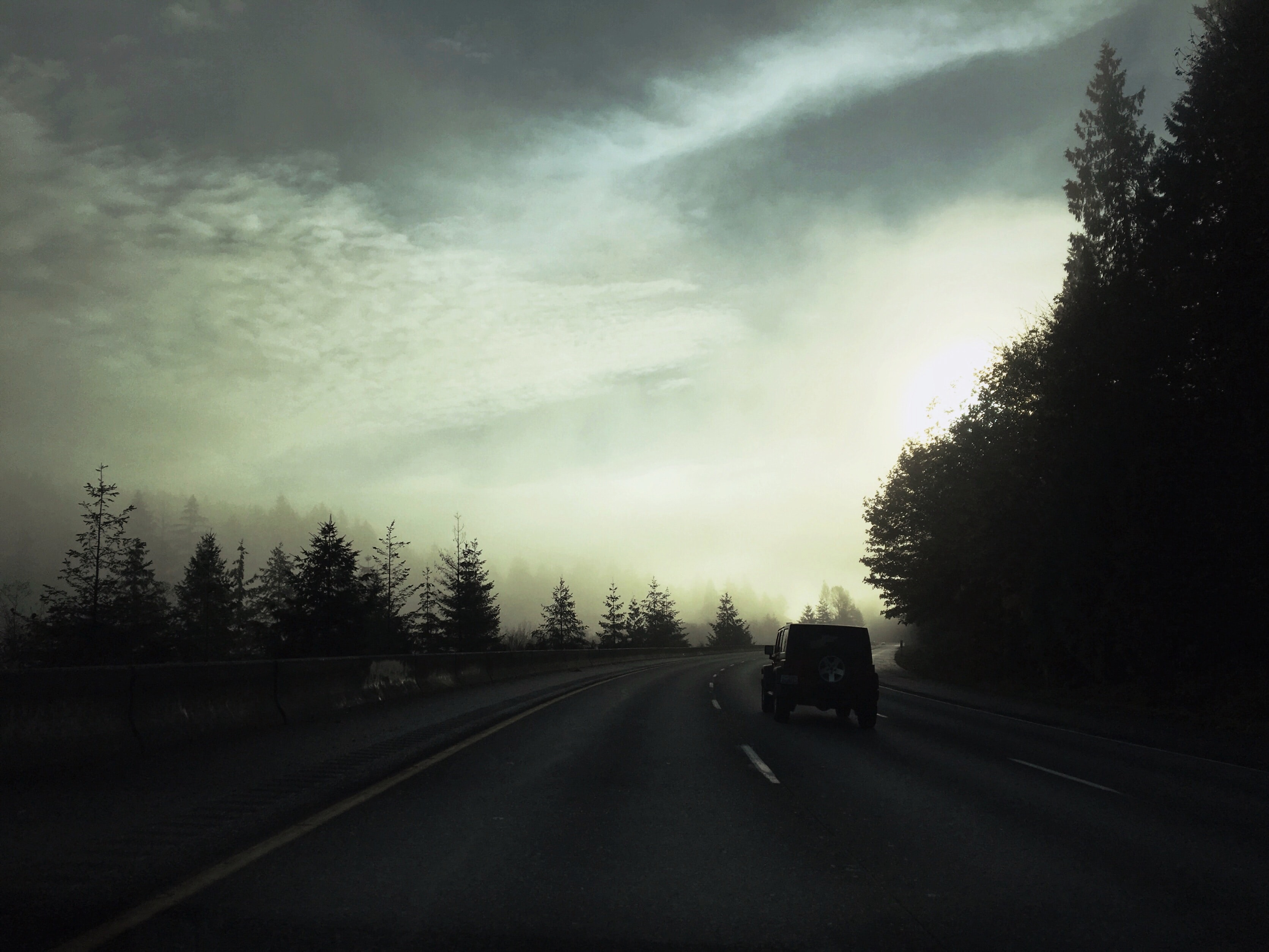 car passing on road