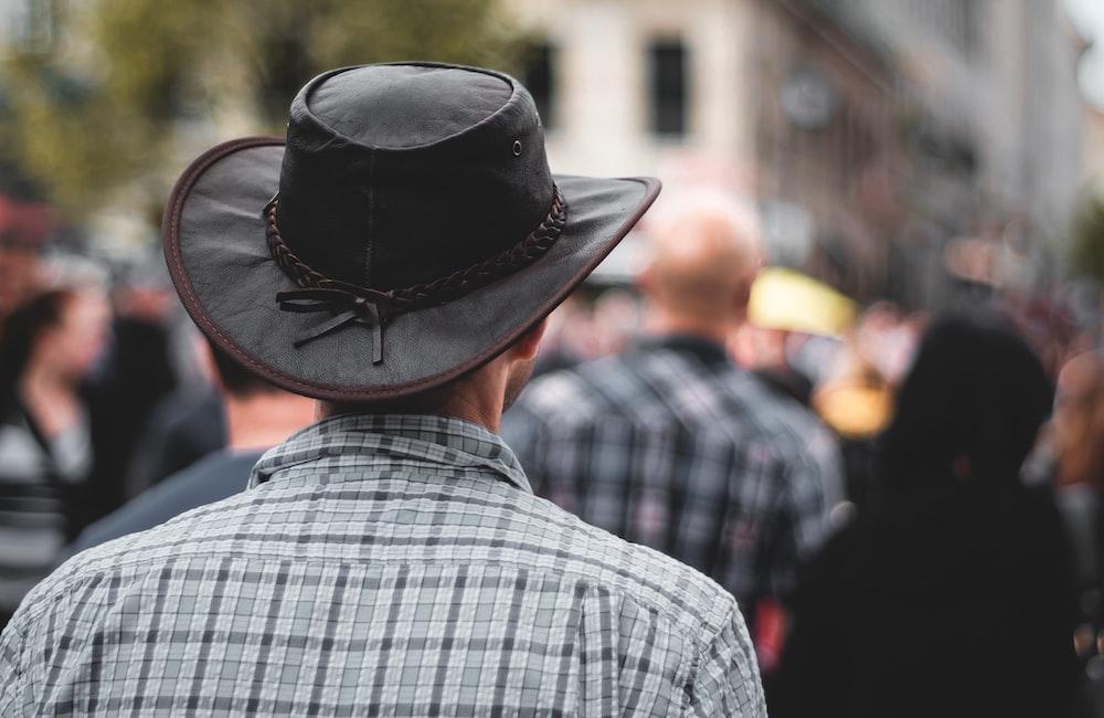 man wearing black cowboy hat