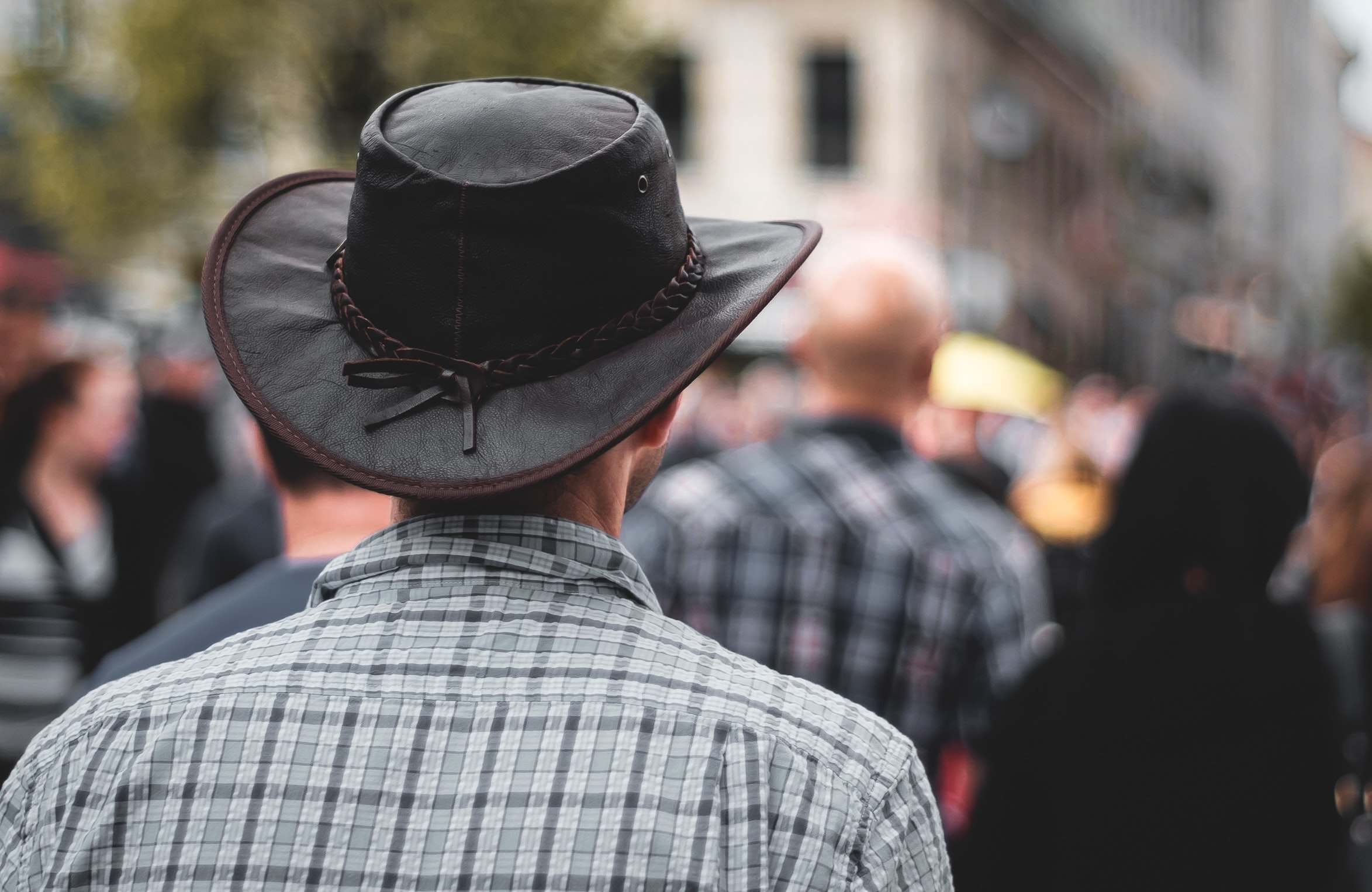 man wearing black cowboy hat