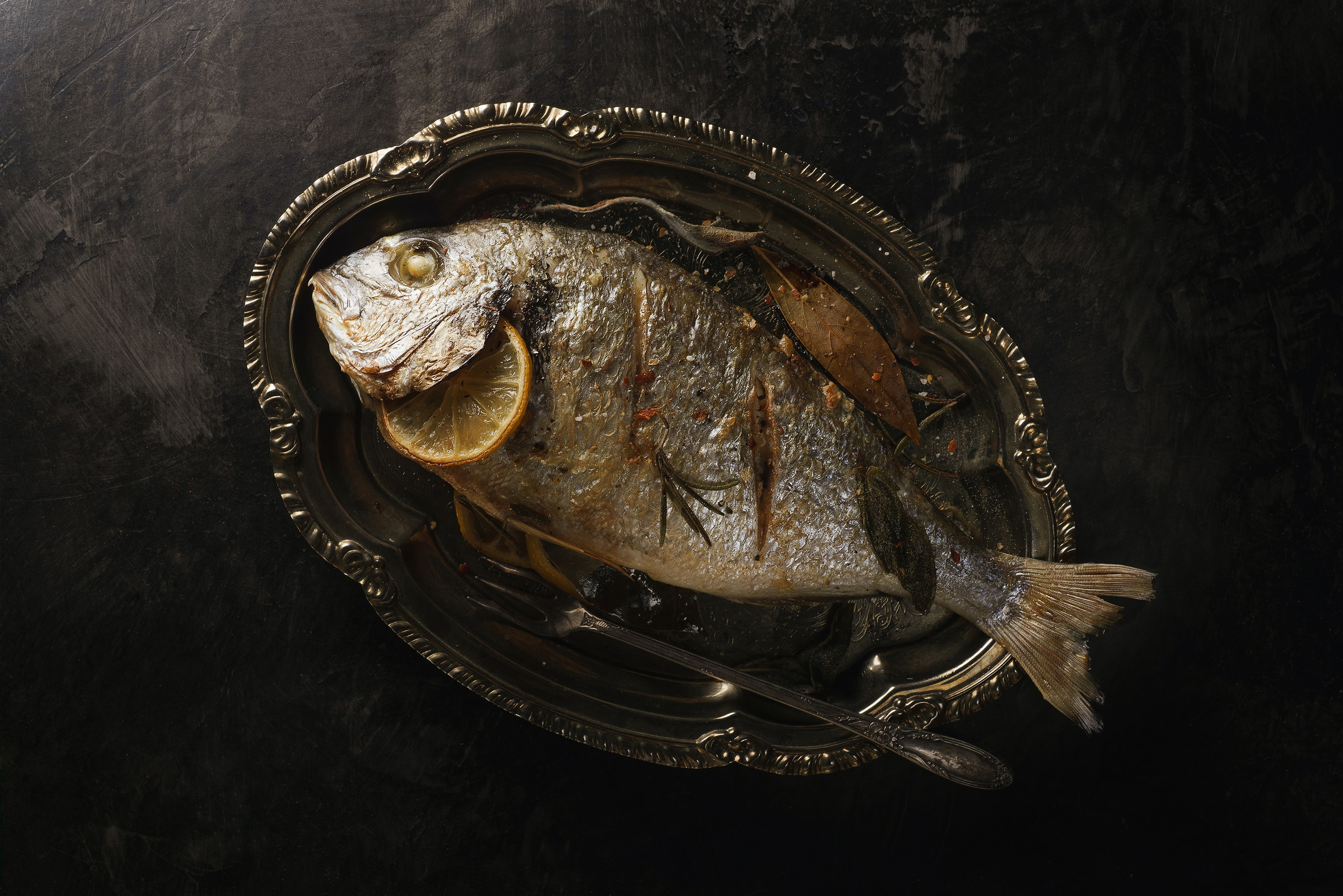 fried fish with lemon in plate