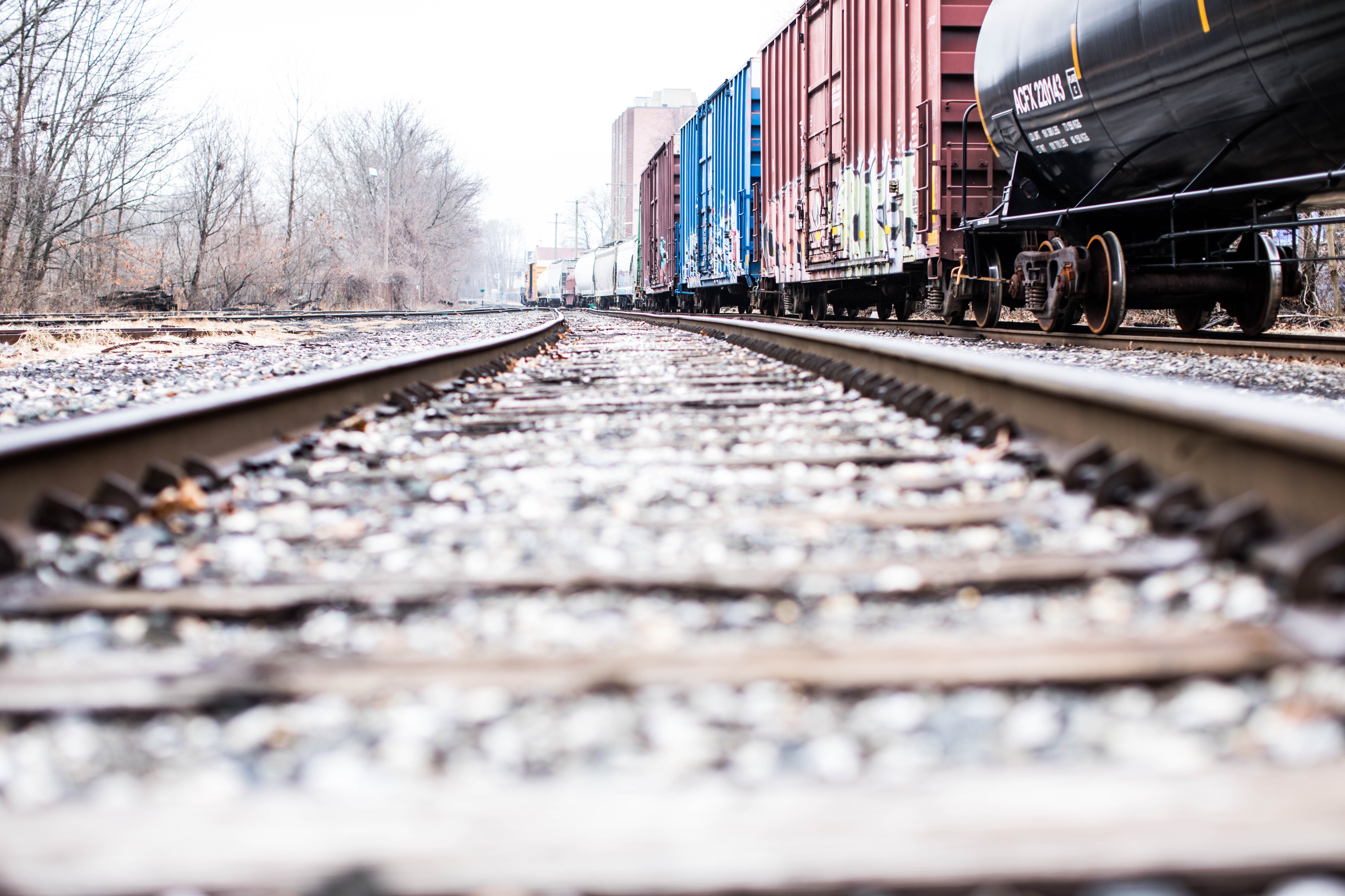 photo of a train rails beside container van