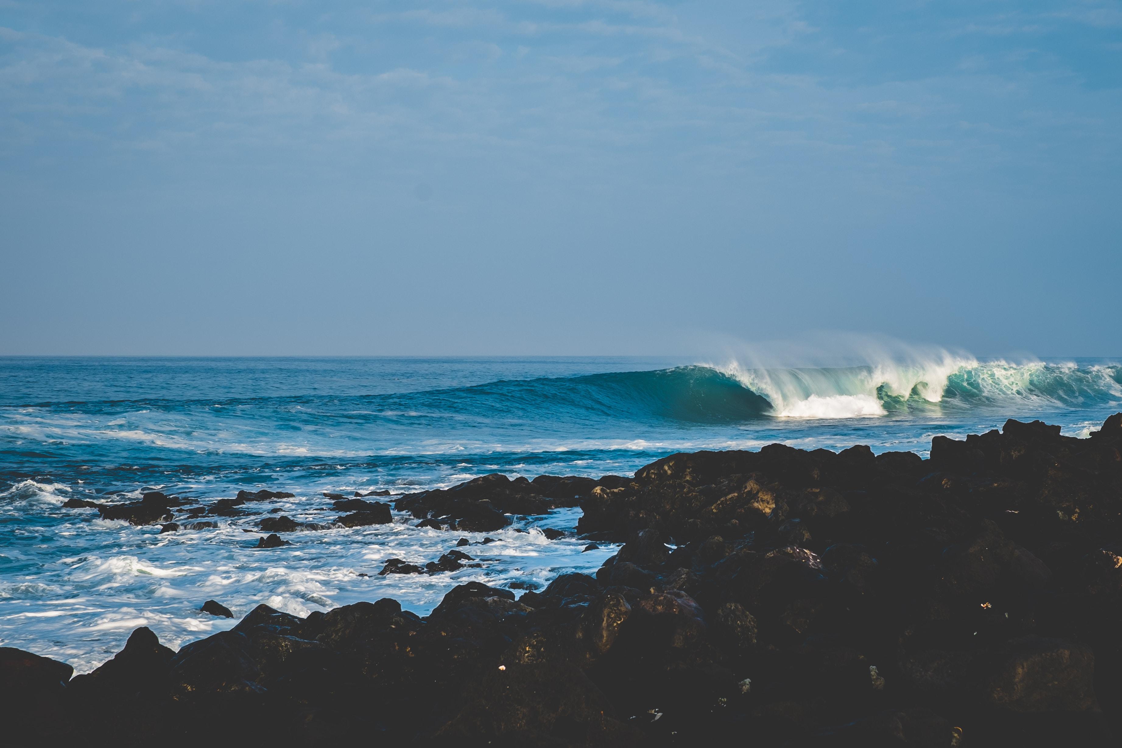 crashing waves through shores
