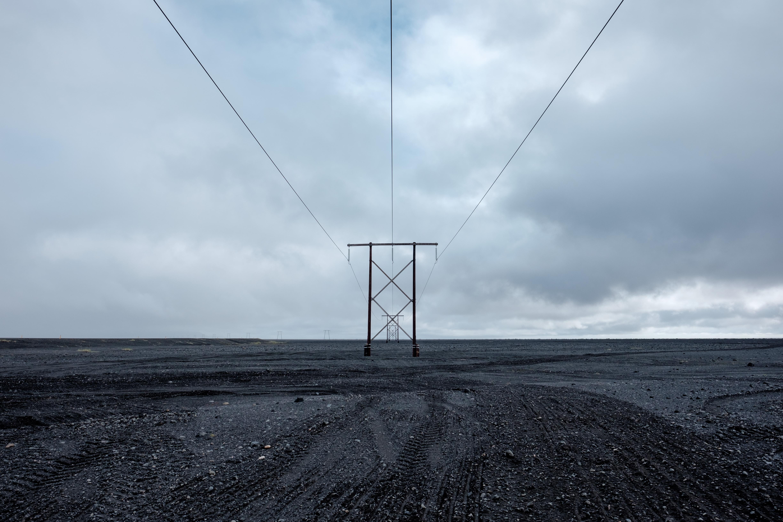 electricity post under cloud sky