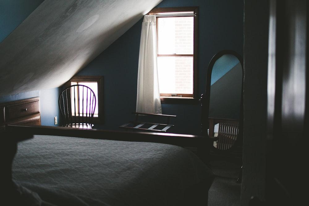 oval mirror near window