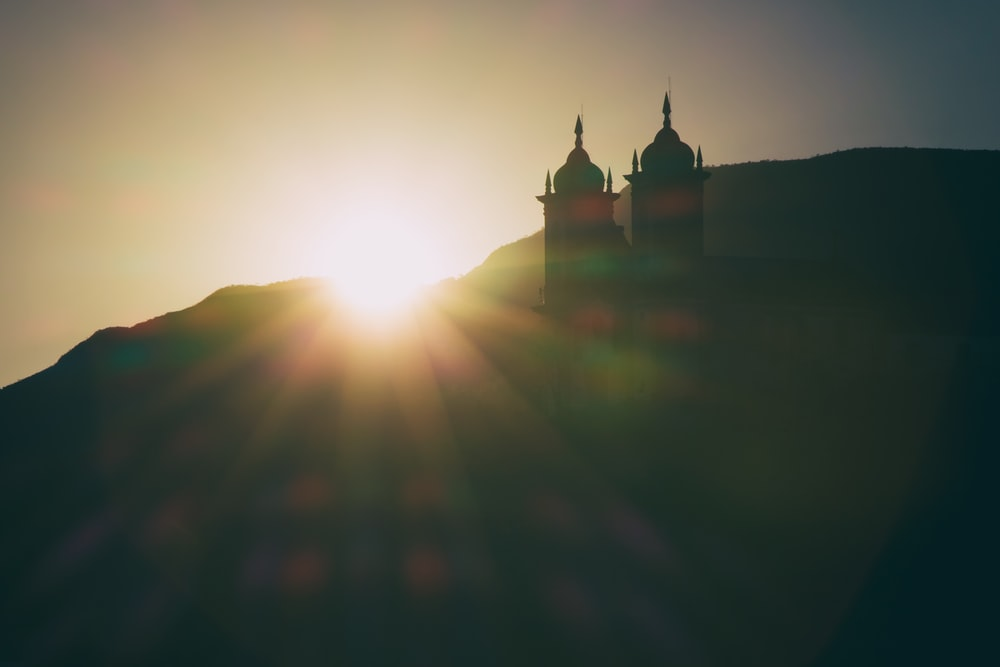 silhouette photo of mosque during golden hour