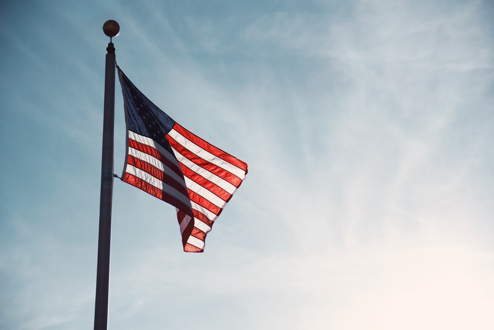 flag of U.S.A on top of flag pole