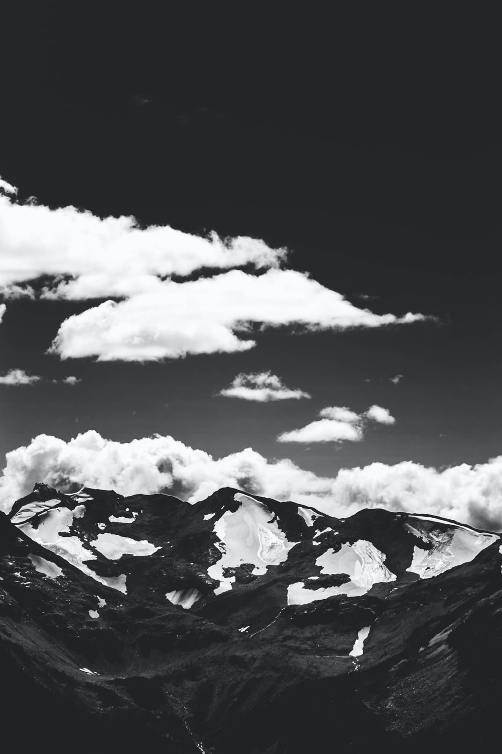 grayscale photo of mountain and clouds