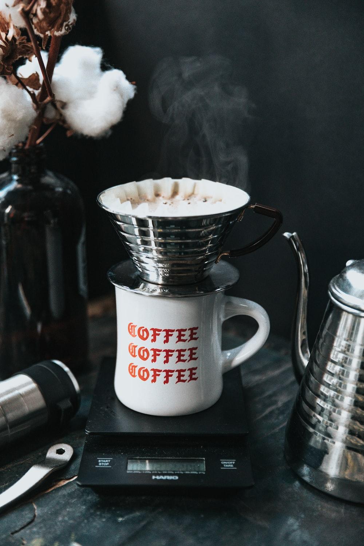 photo of white mug on burner