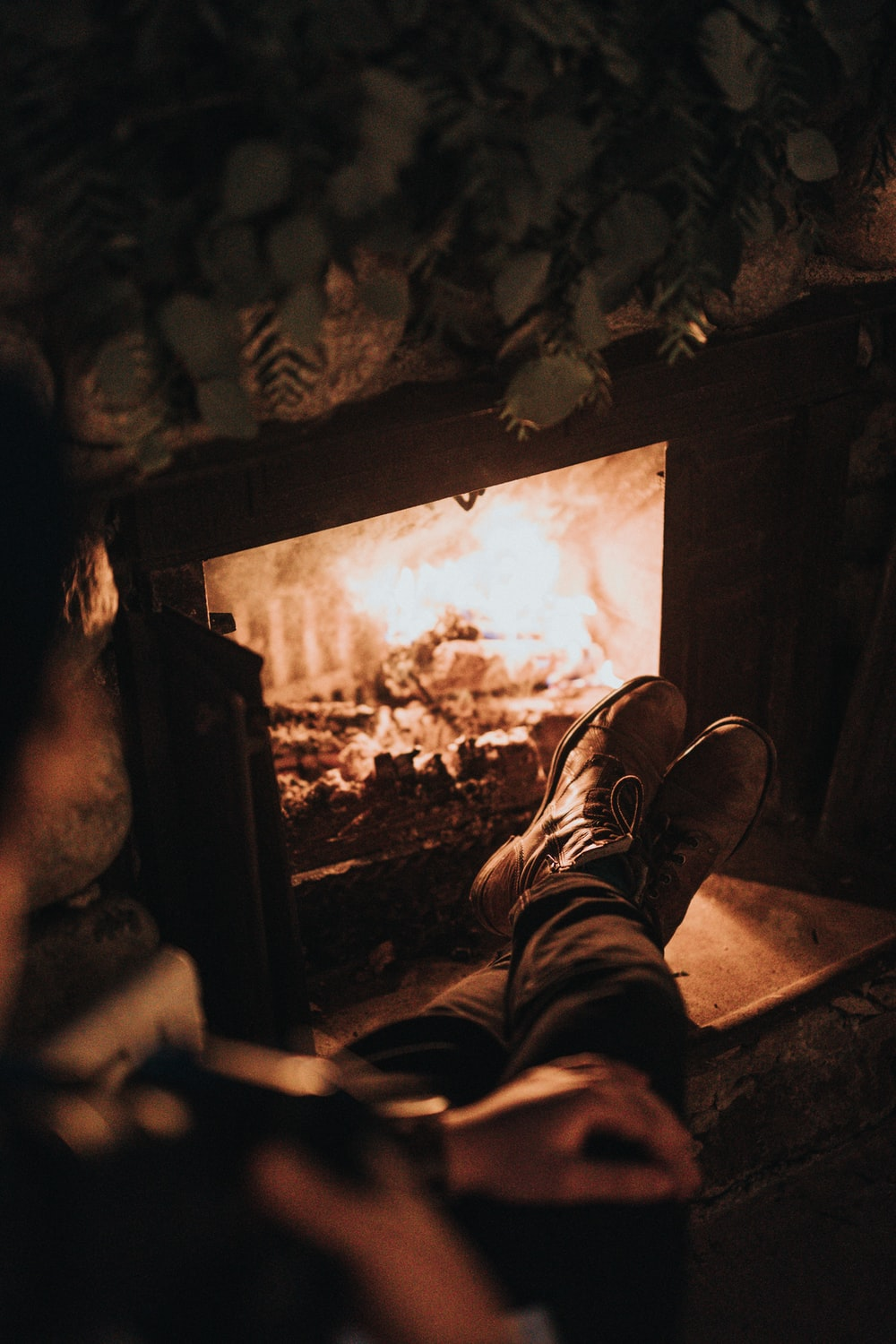 man sitting in front of the fireplace