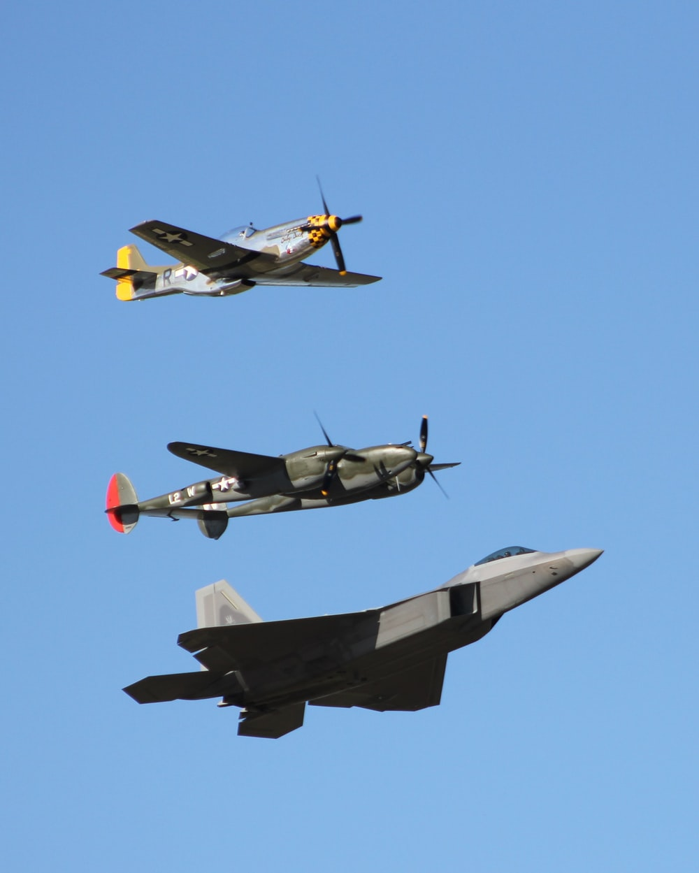 three assorted-color fighter jets