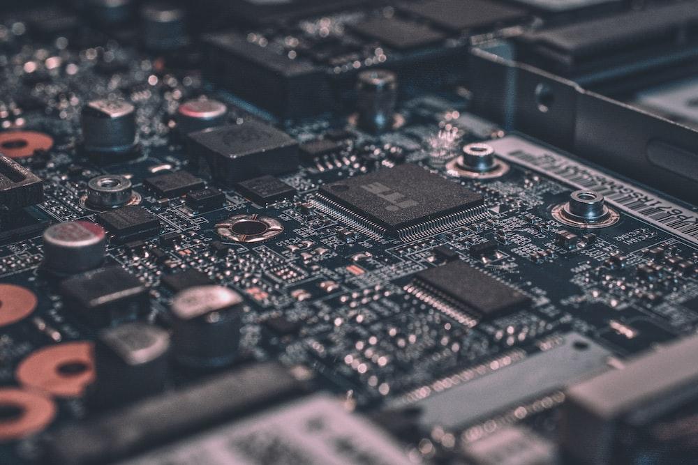 macro photography of black circuit board