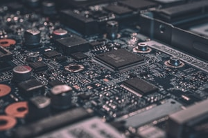 macro photography of black circuit board