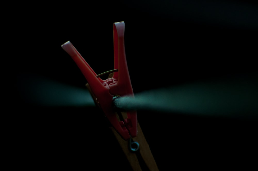 red plastic clothes clip