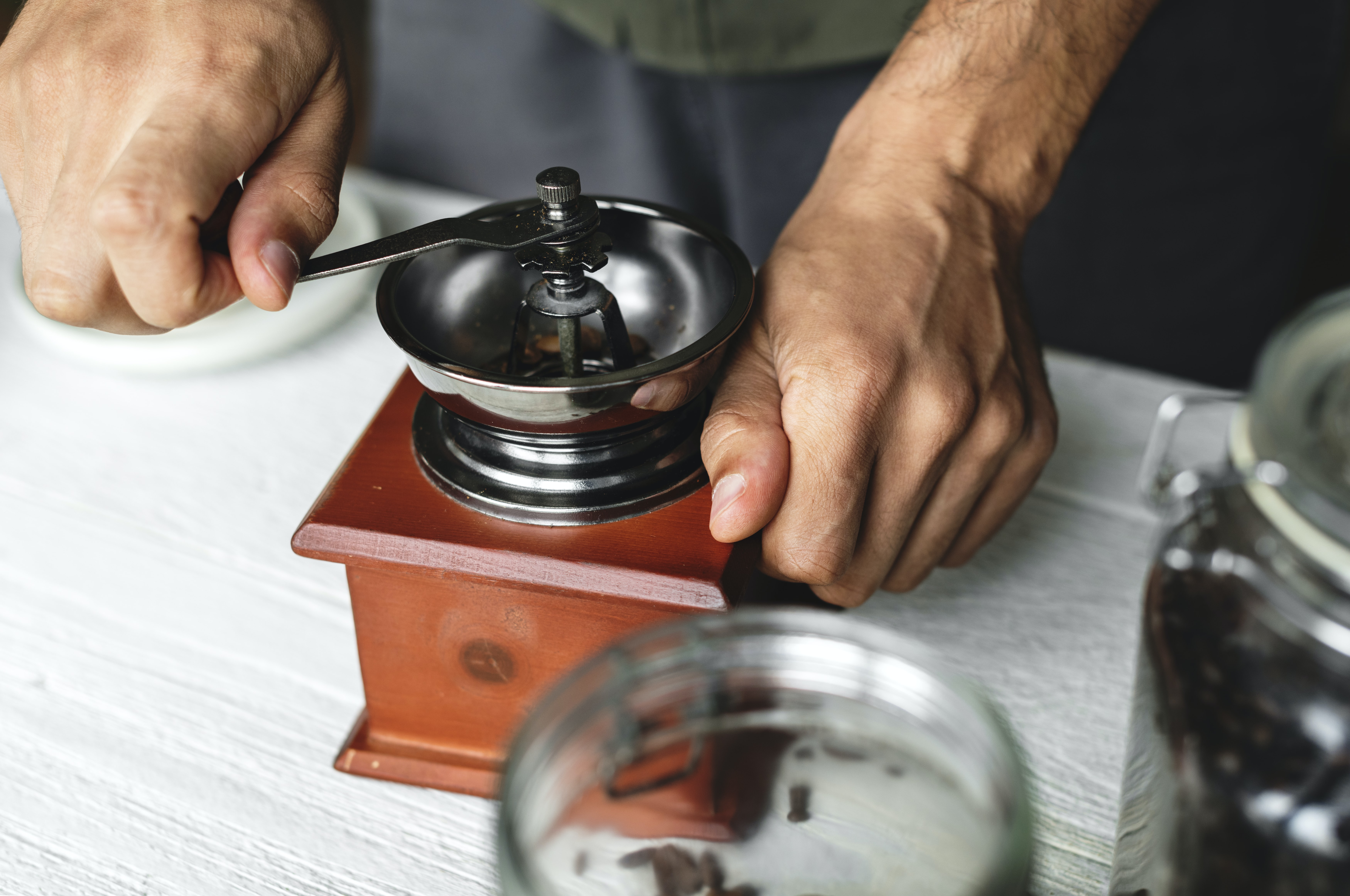 person holding round silver equipment