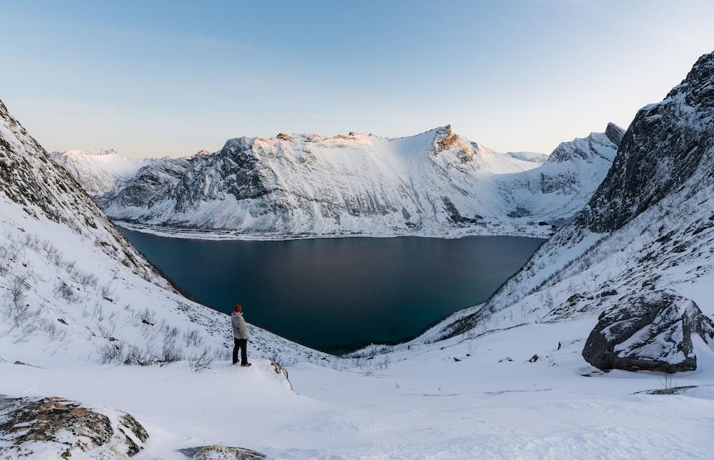 man standing on snow path