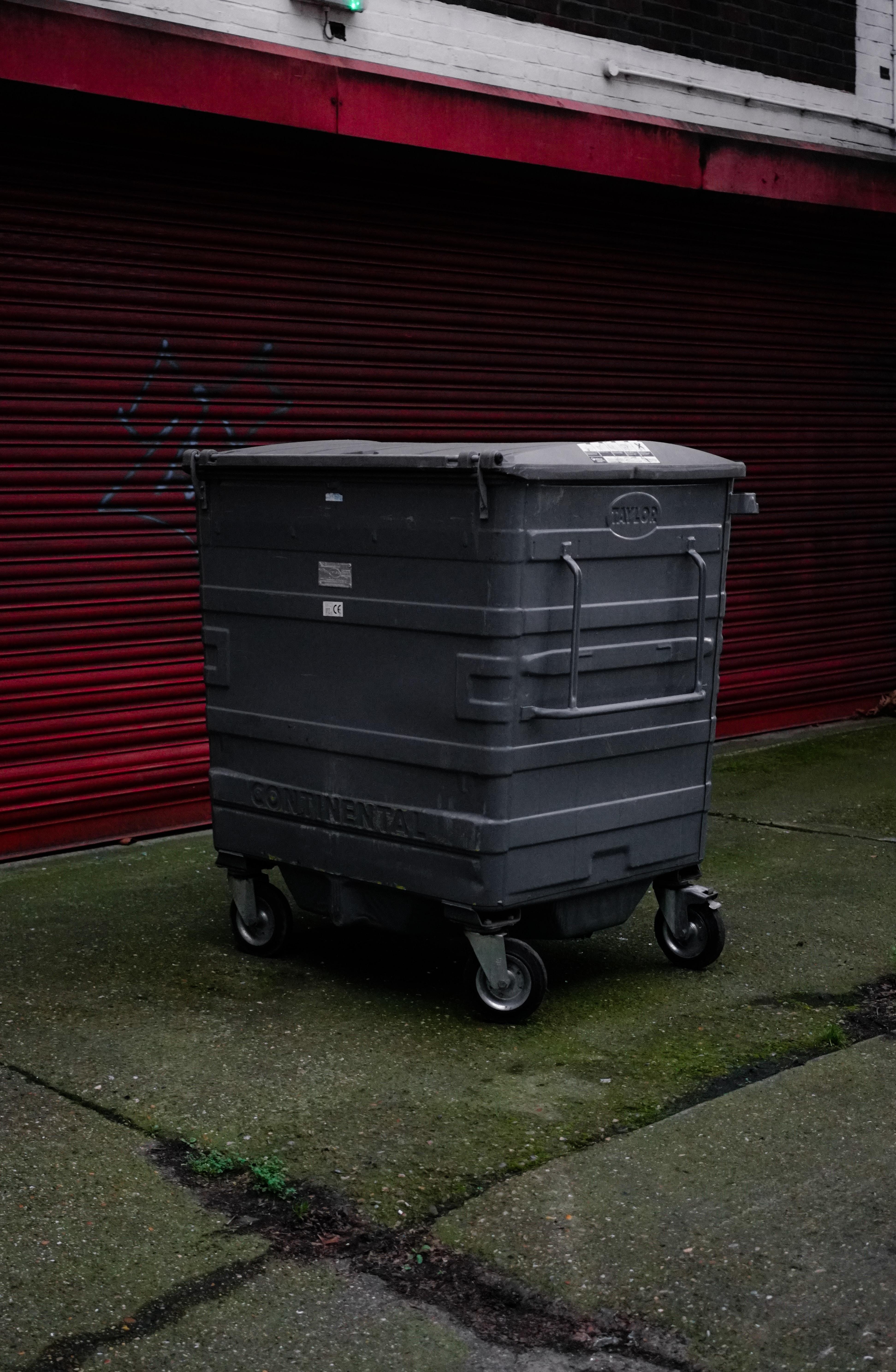 gray wheeled trash bin