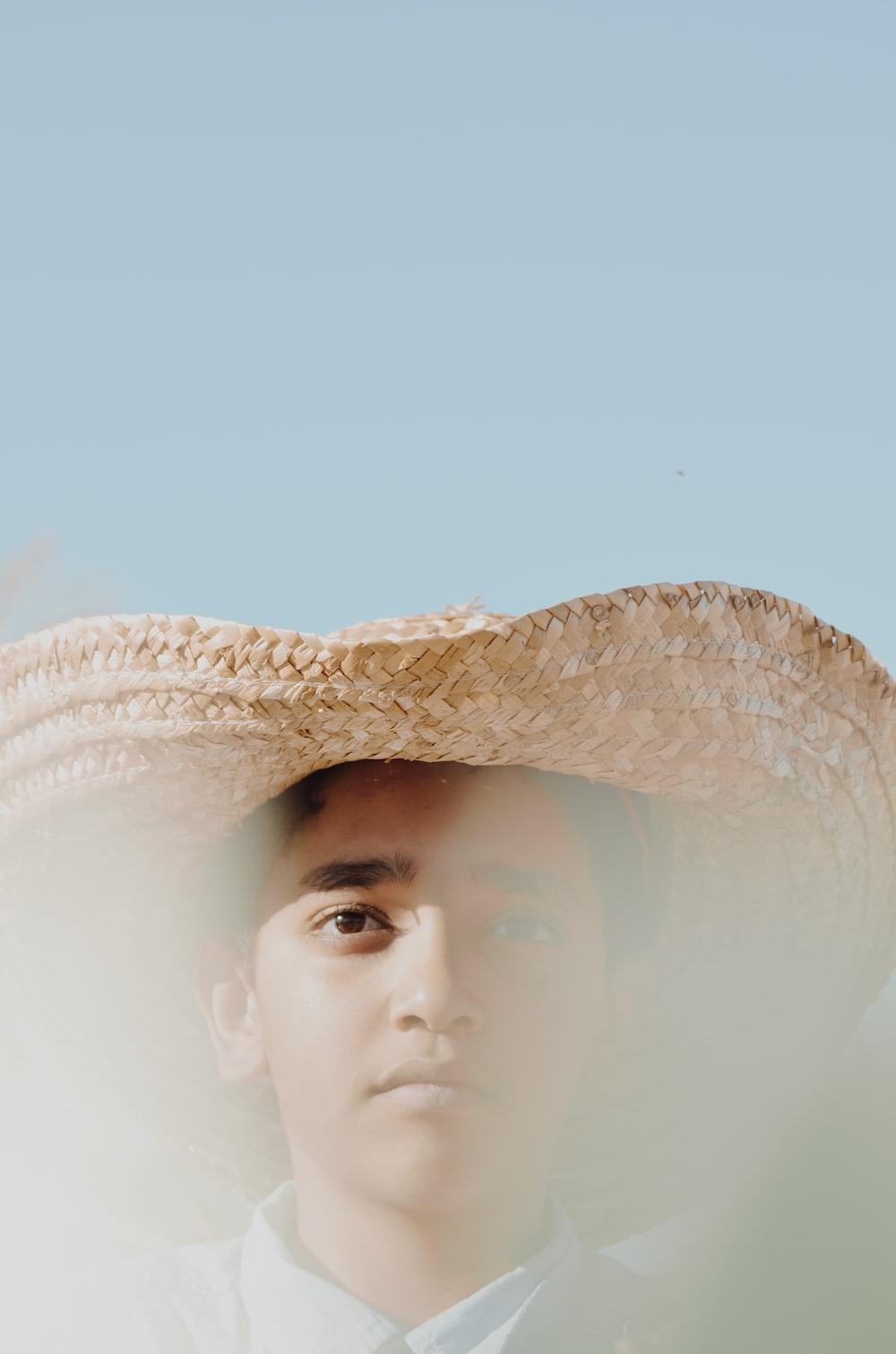 man wearing brown hat