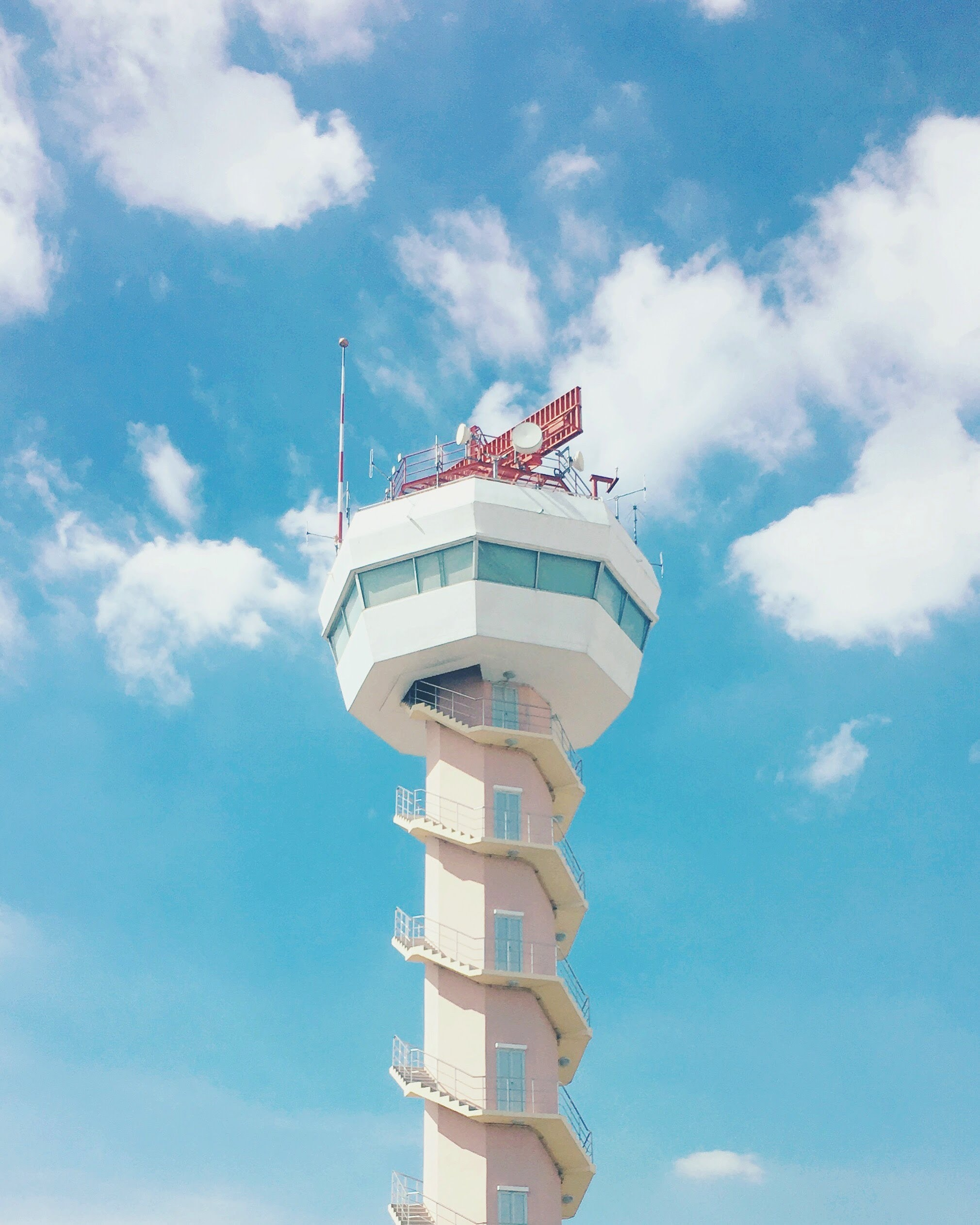 white airport tower under blue sky