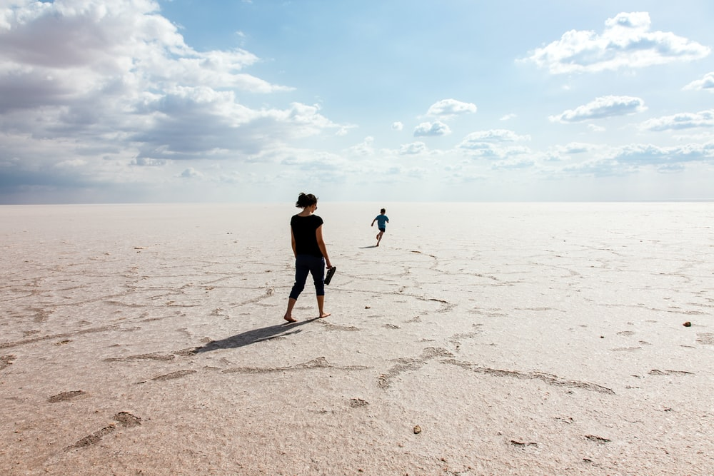 woman and boy walking on deserted location