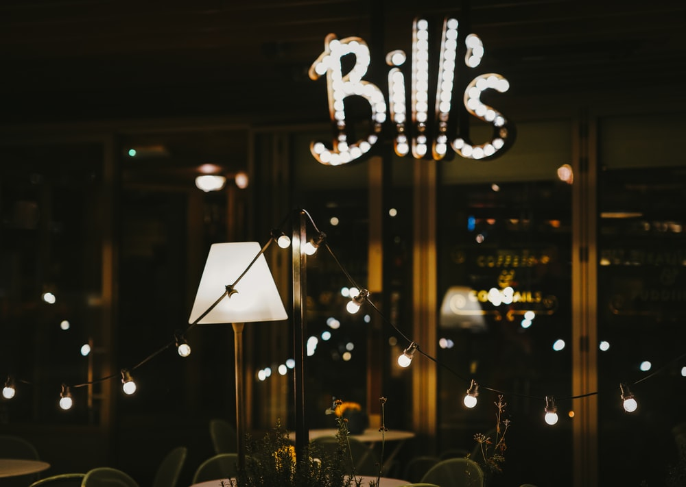 shallow focus photography of white Bill's LED signage