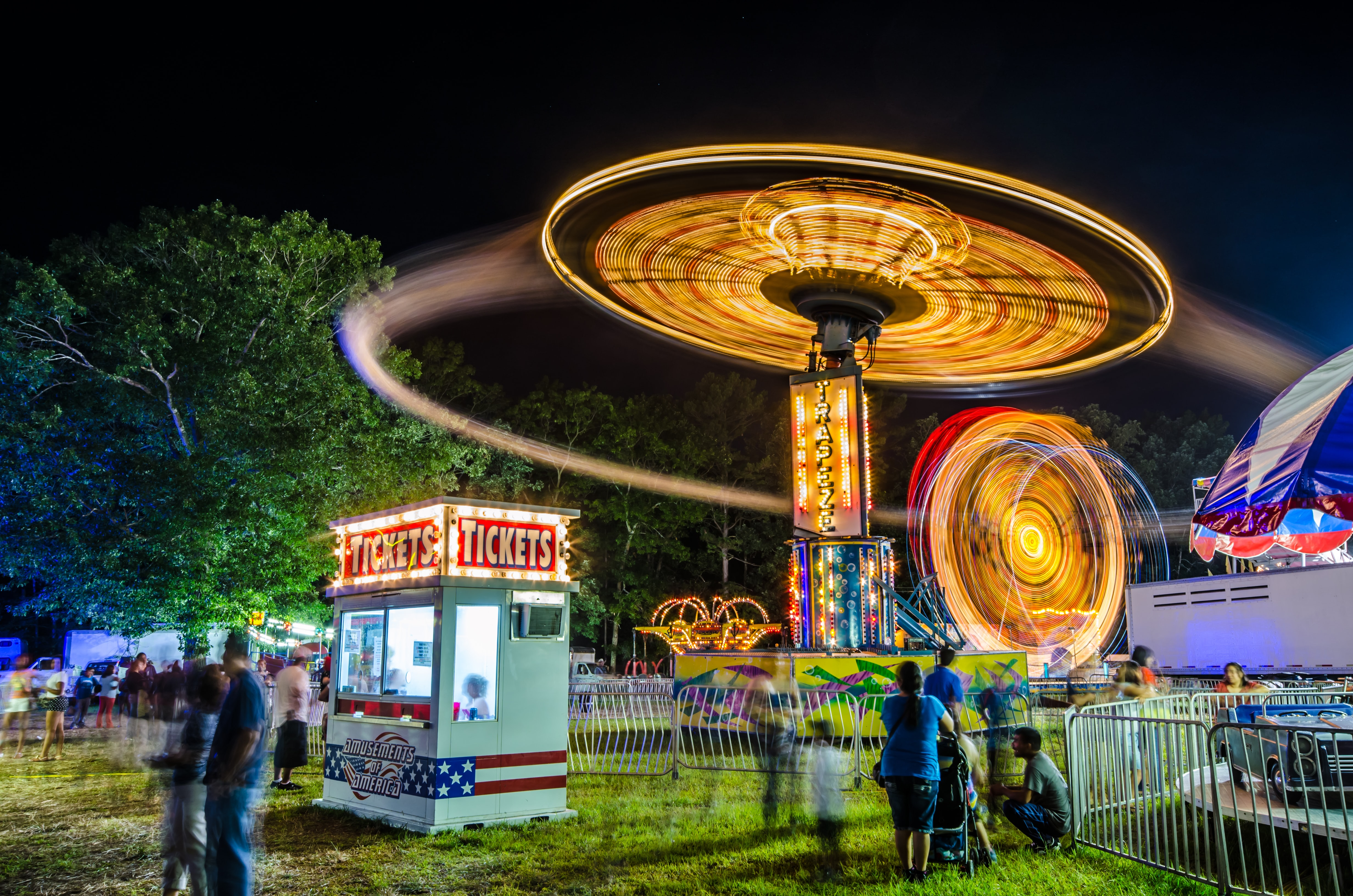 time-lapsed photography of amusement park rides