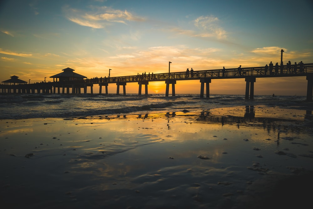 silhouette of beach dock during golden hour