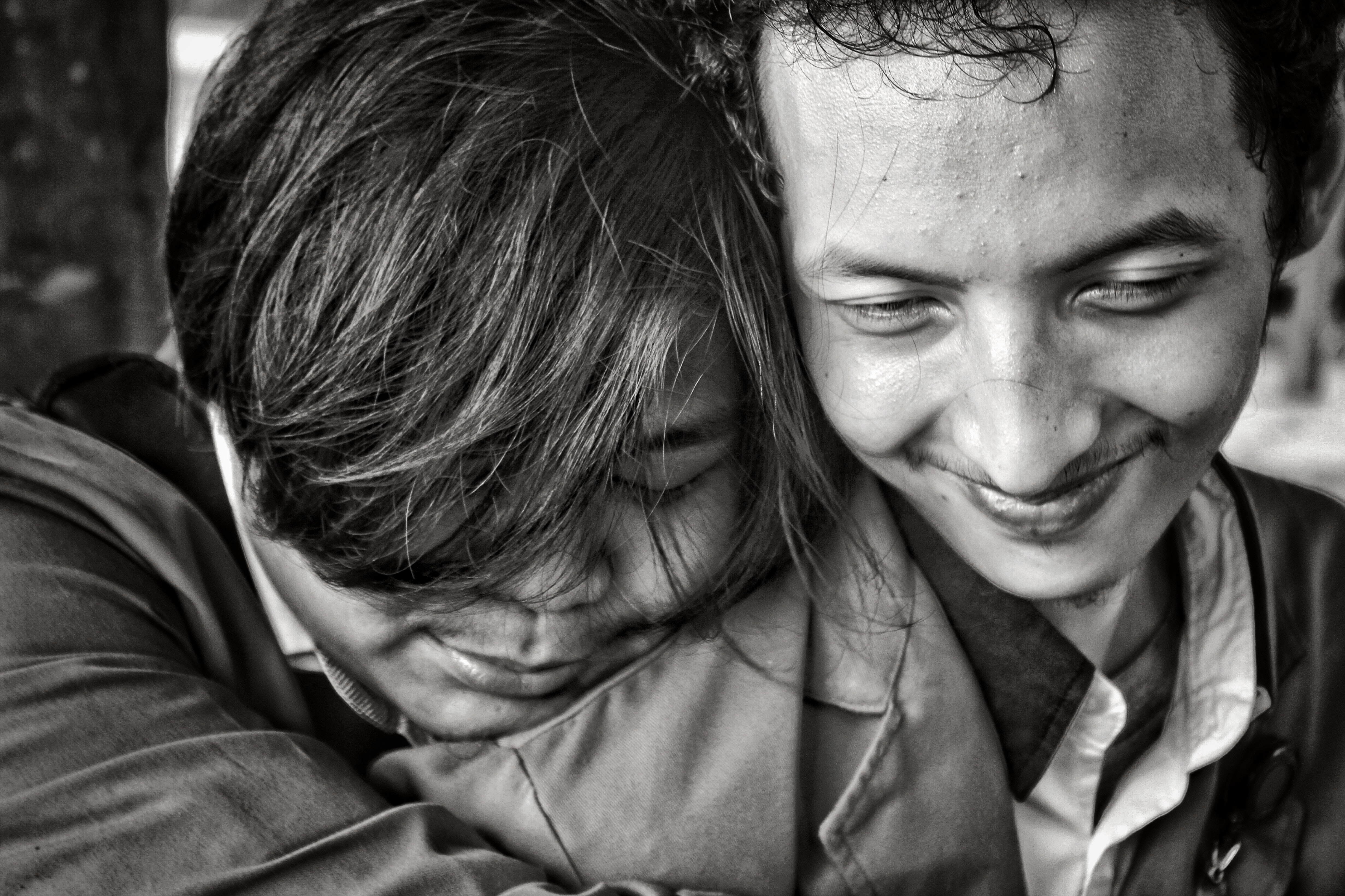 greyscale photo of two people close to each other