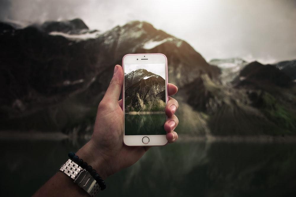 person taking photo on mountain