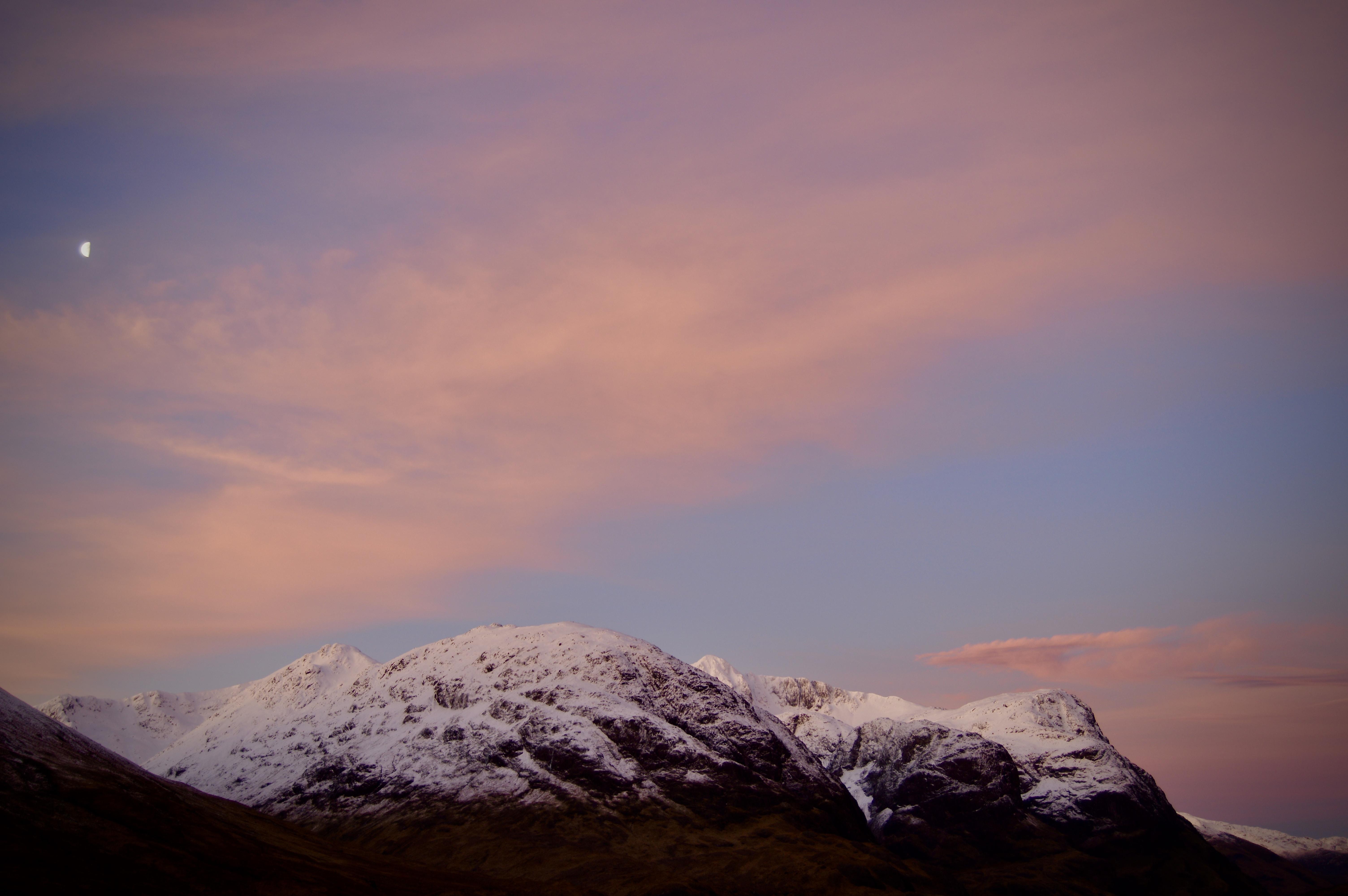 snowy mountain under gray sky