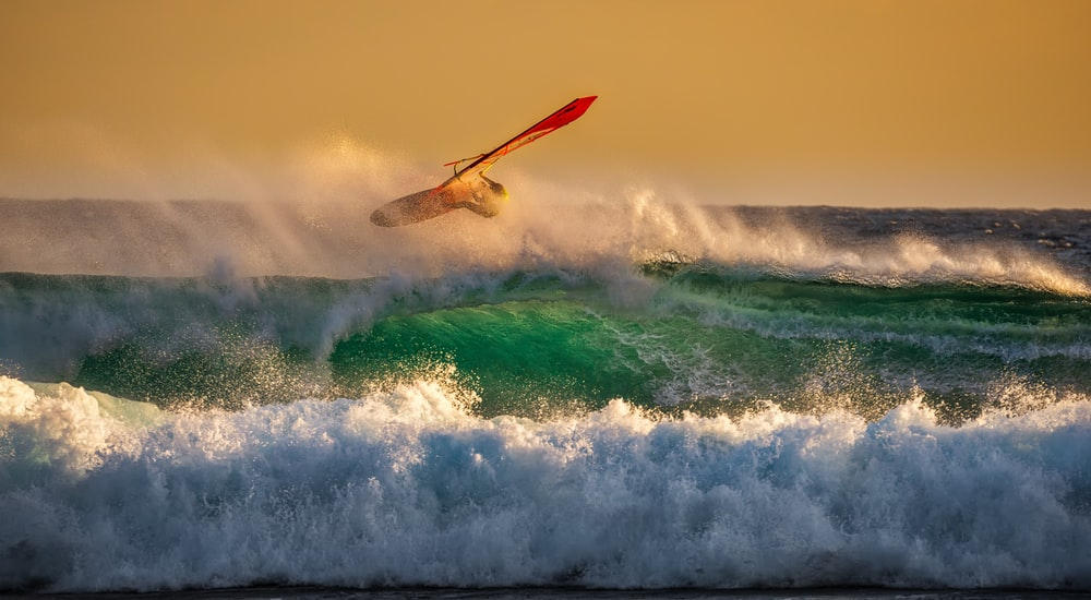 man surfing on top waves