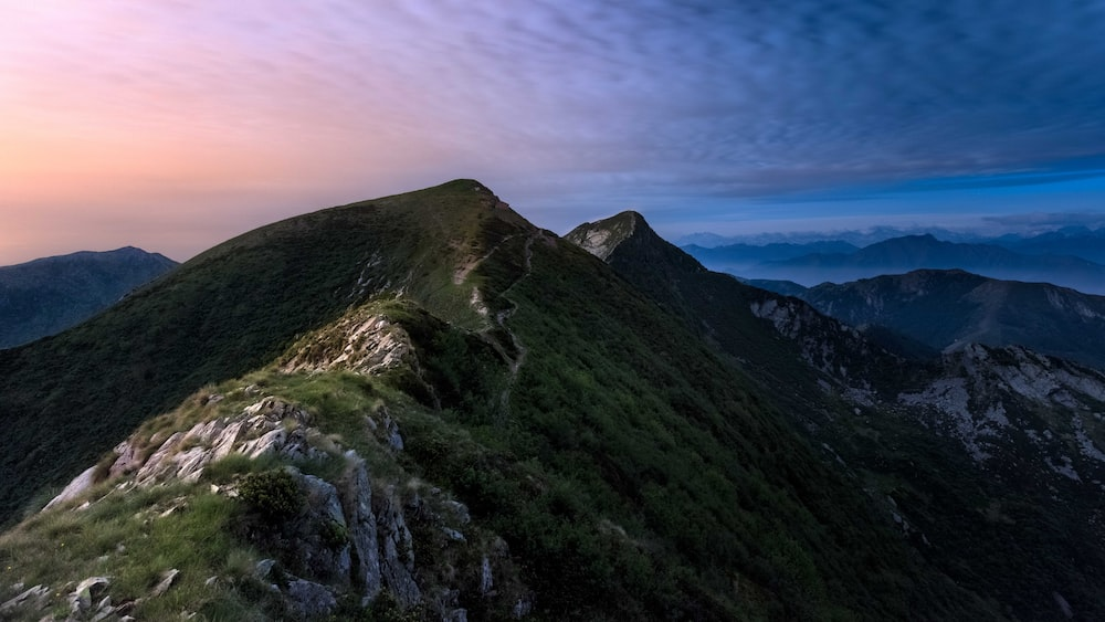 landscape photography of green mountains